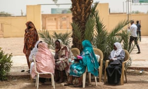 Women take part in a sit-in by Sudanese opposition parties in Khartoum.