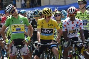 Peter Sagan, left, Chris Froome and Daniel Teklehaimanot wait at the start.