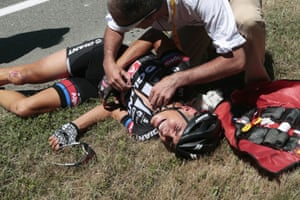 A medic tends to Warren Barguil after he crashed in the feeding zone.