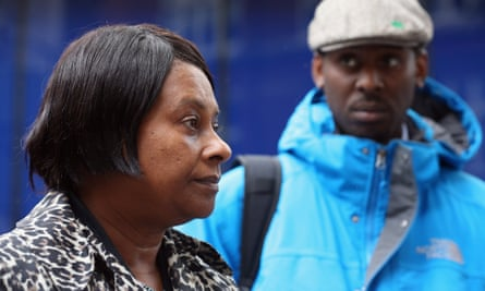 Doreen Lawrence, with her son Stuart, after a meeting with Sir Bernard Hogan-Howe, the Commissioner of the Metropolitan Police, in 2013.