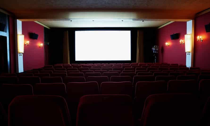 An illuminated screen in an empty cinema theatre