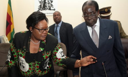 Joice Mujuru with Robert Mugabe in October 2014 shortly after the first lady Grace Mugabe called for Mujuru's resignation as vice-president.