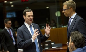 George Osborne, second left, speaks with Dutch finance minister Jeroen Dijsselbloem, rightduring a meeting of EU finance ministers at the EU Council building in Brussels.