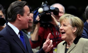 David Cameron talks with Germany's chancellor Angela Merkel