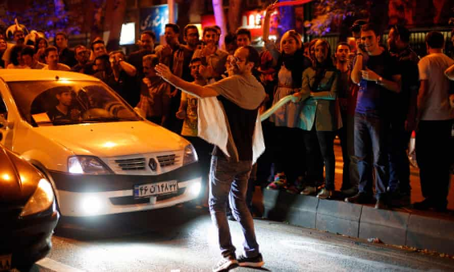 Iranians celebrate in the street of Tehran after nuclear talks between Iran and world powers ended in Vienna, Austria.