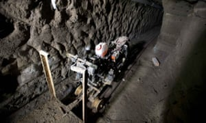 El Chapo's rail-running escape motorcycle sits in the tunnel under the half-built house where authorities say he made it to freedom.
