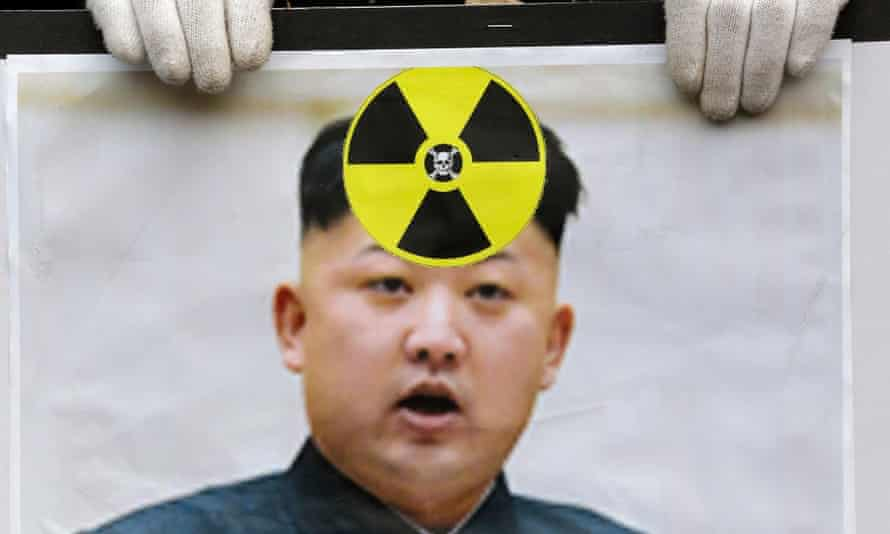 A South Korean protester holds a picture of Kim Jong-un during a rally following a nuclear test conducted by North Korea in February 2013.