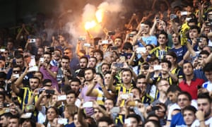 Fenerbahce fans take pictures as Van Persie is presented in Istanbul.