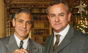 George Clooney and Hugh Bonneville on the set of Downton last year.