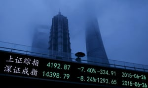 An electronic board shows the plunging Shanghai and Shenzhen stock indices, in Shanghai's Pudong financial district.