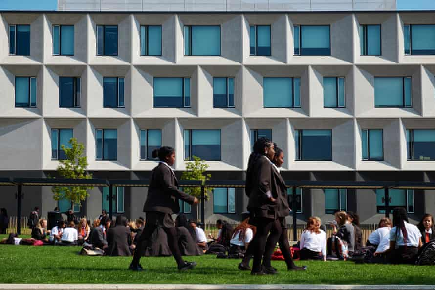 With its chamfered precast concrete panels and generous light-flooded classrooms, the building recalls school design from another era.