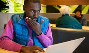Activist DeRay Mckesson updates his website and posts updates to Twitter from a McDonald's in Ferguson.