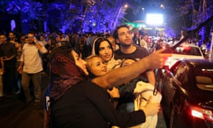 Iranians celebrate the nuclear agreement in Tehran.
