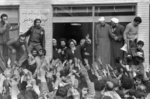 Ayatollah Khomeini, center, waves to followers as he appears at the window of his headquarters in Tehran, Iran on 2 February 1979, the second day of his return from exile.
