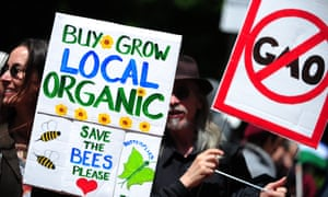 Protesters hold up placards against Monsanto and the use of glyphosate in the US.