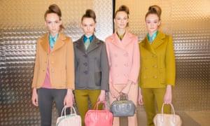 Models backstage at this season's Prada show, Milan fashion week.