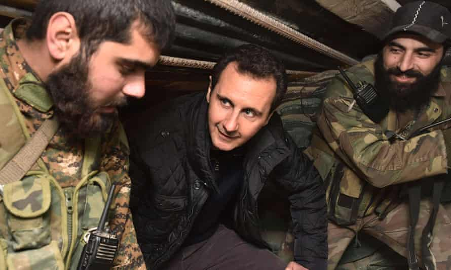 President Bashar al-Assad talks to soldiers during a visit to Jobar