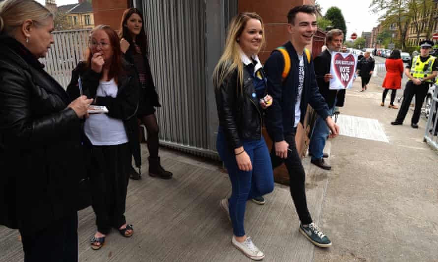 Young people leaving a polling station in Scotland.