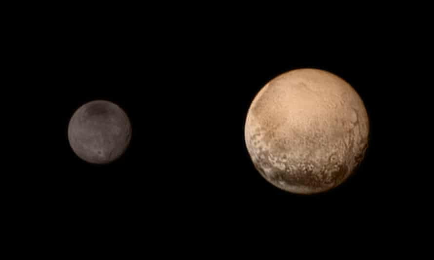 Pluto and Charon display striking color and brightness contrast in this composite image from 11 July.