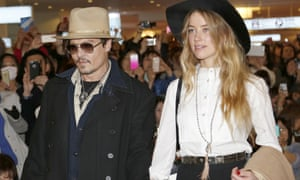 Johnny Depp and Amber Heard. She has been charged with illegally bringing the couple's dogs to Australia.