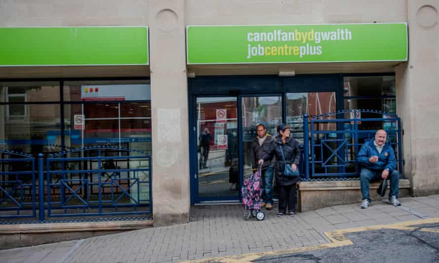 Waiting outside a Jobcentre Plus in Wales.