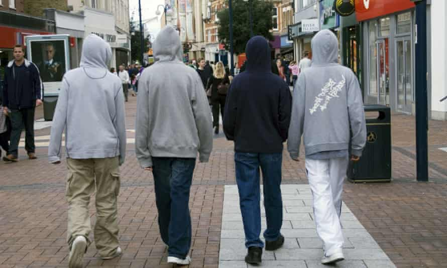 a group of young boys in hoodies.