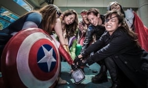 costumed fans attend Comic-Con
