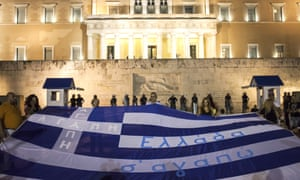 Greek citizens protest with giant flag
