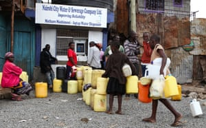Kenyans queue at one of the new ATM-style water dispensers installed in the Mathare slums in Nairobi. The new system, which uses a smart card, aims to provide cleaner and cheaper water to slum-dwellers.