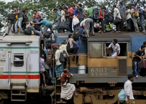 Dhaka, Bangladesh Muslims climb on to the roof of an overcrowded train as they head to their homes for the Eid al-Fitr holiday