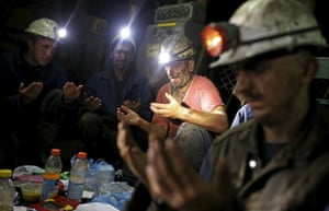 Miners pray as they break their fast during the holy month of Ramadan, 750 metres down the Stara Jama coalmine