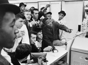 African-American students attempt to get served at a lunch counter reserved for white customers in Virginia in 1960.