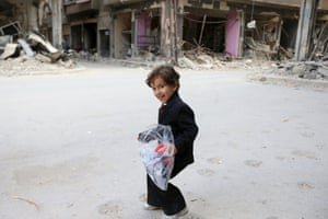 Damascus A boy carries a bag of new clothes as Syrians celebrate the end of Ramadan