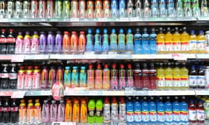 Soft and fizzy drinks on a supermarket shelf.