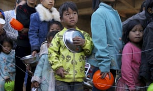 Children queue for food at a refugee camp on the Burma-China border.