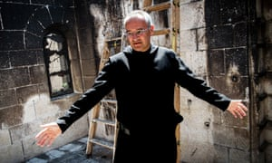 Fr Matthias shows the damage done to the church and monastery by suspected Jewish extremists.