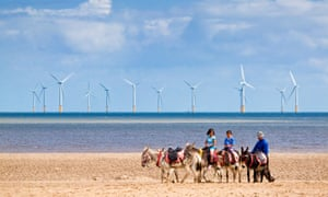 A windfarm off the coast at Skegness. Offshore wind farms are generating more electricity than expected.