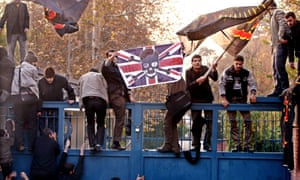 Hundreds of Iranian students breaking into the British embassy, in Tehran on 29 November 2011.