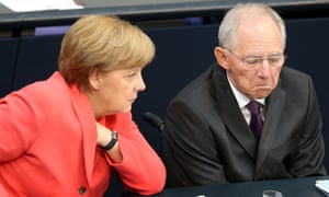 German chancellor Angela Merkel and finance minister Wolfgang Schäuble talk during a special meeting of the lower house of the German parliament.