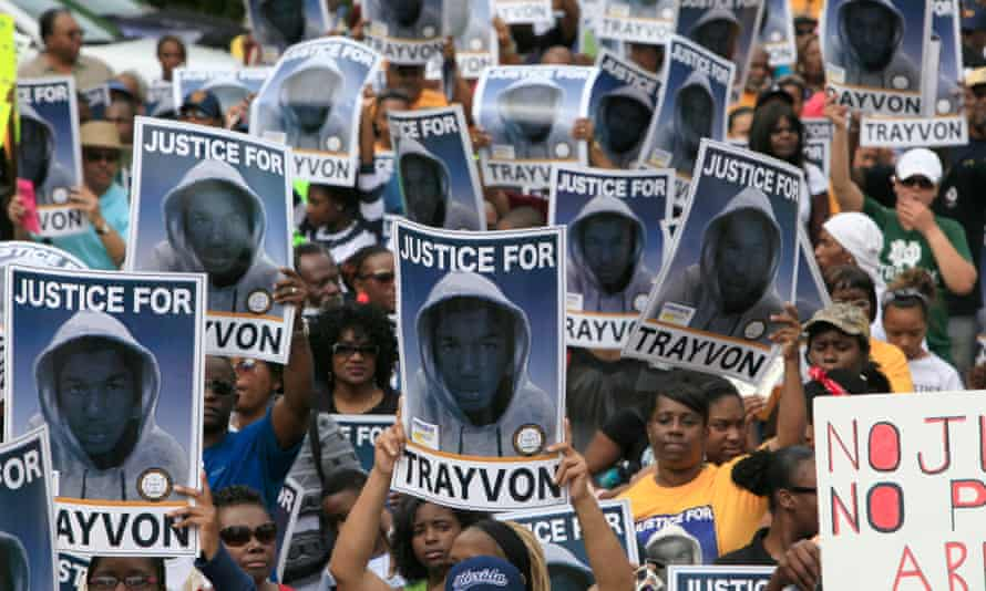 Protesters hold signs during a march and rally for Florida teenager Trayvon Martin in 2012.