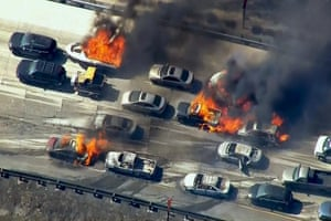 Cars burn on the Interstate 15 freeway at the Cajon Pass, California, in a videograb from KNBC. A brush fire burning in the foothills overran a freeway, torching several vehicles as drivers scrambled to safety.