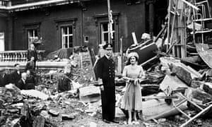 King George VI and Queen Elizabeth stand amid the bomb damage at Buckingham Palace.