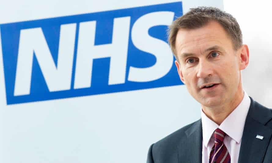 Health secretary Jeremy Hunt next to NHS logo