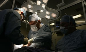 Transplant taking place at Queen Elizabeth hospital Birmingham. The BHF has called for it to be assumed people are prepared to donate unless they declare otherwise.