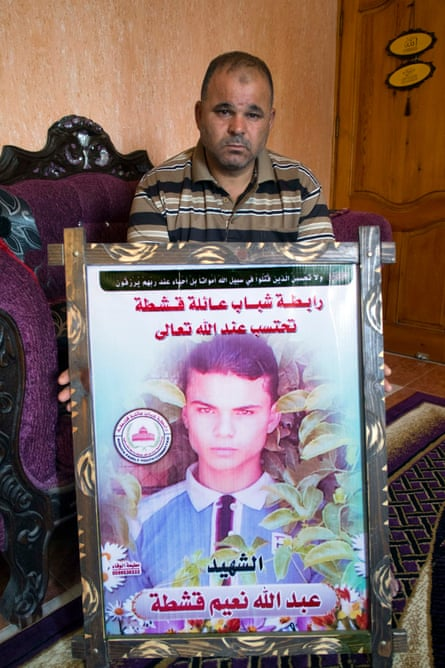 Naim Qishta holds a picture of his son Abdullah, a pupil at Doha school, killed during last summer's war in Gaza during an Israeli attack. The Doha boys' secondary school in Rafah lost more pupils during the war than any other.