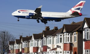 A British Airways 747 aircraft flies over roof tops as it comes into lane at Heathrow Airport in west London.