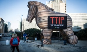 Friends of Earth Europe aet up inflated Trojan horse as they hold the prostest against TTIP agreement in front of EU headquarters in Brussels, Belgium on 4 February 2015