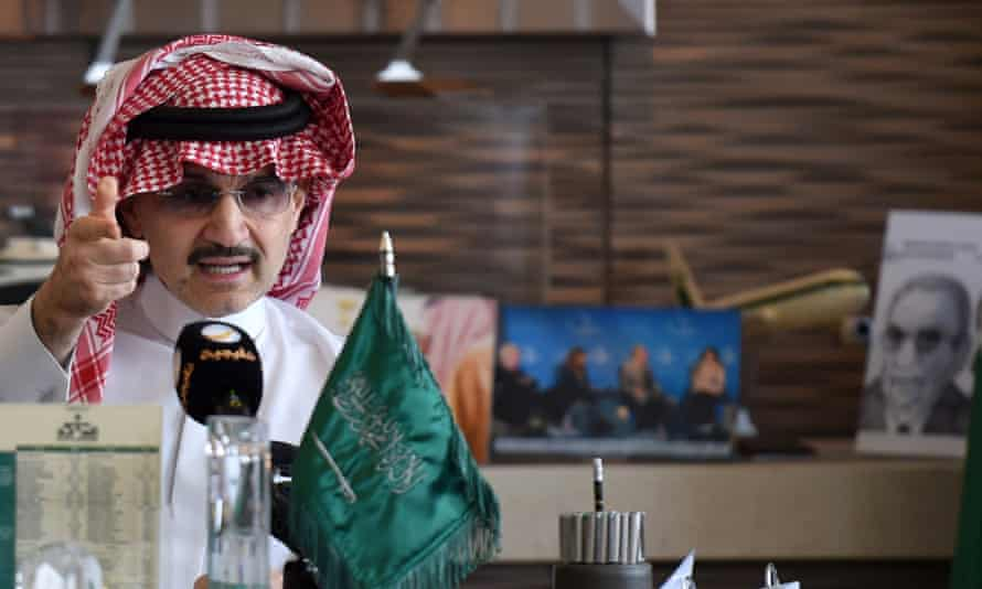 """Saudi Arabia's billionaire Prince Alwaleed bin Talal gestures during a press conference in the Saudi capital, Riyadh, on July 1, 2015. Alwaleed pledged his entire $32-billion (28.8-billion-euro) fortune to charitable projects over the coming years. The prince said in a statement that the """"philanthropic pledge will help build bridges to foster cultural understanding, develop communities, empower women, enable youth, provide vital disaster relief and create a more tolerant and accepting world."""""""