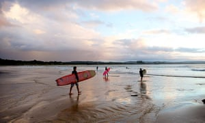 Evening mood with surfers at Watego Beach near Cape Byron, New South Wales