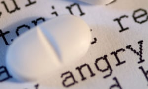 Pills on top of word 'angry'